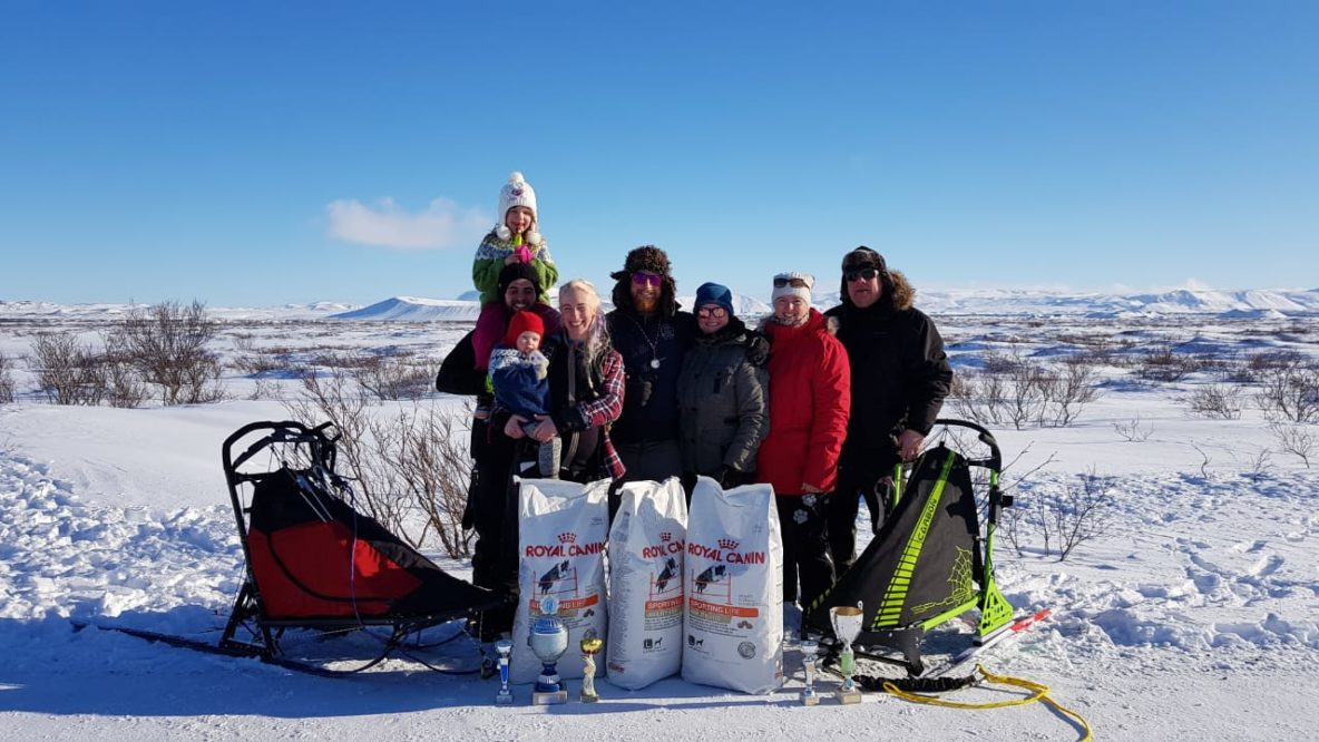 dog sledding winners posing dog food trophies race myvatn